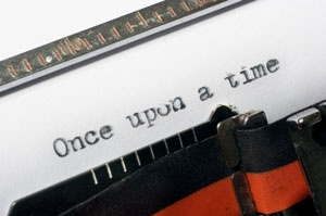 "Photograph showing paper in an old-fashioned typewriter bearing the words ""Once upon a time""."