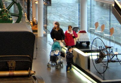 Photograph of mothers and children in a National Waterfront Museum gallery.